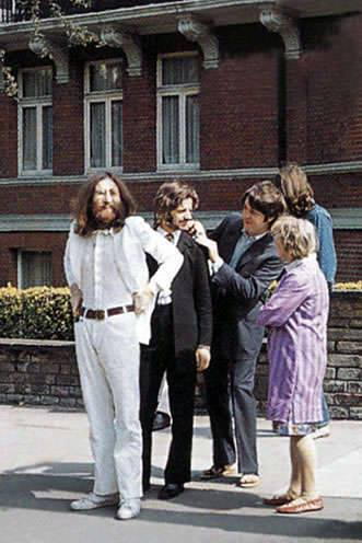 "AUGUST 8, 1969 - The photo session for the cover of The Beatles ""Abbey Road"" album took place on the crossing outside Abbey Road studios."